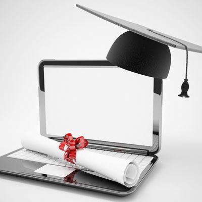 computer and graduation cap